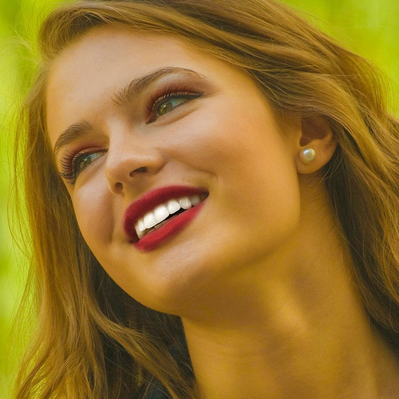 beautiful unlined woman's face to illustrate results of dermal fillers
